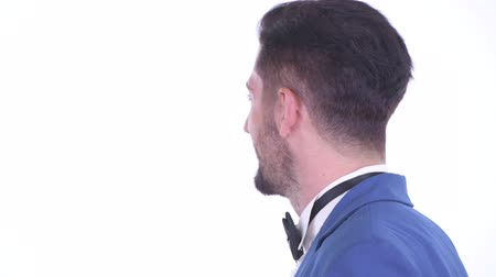 yandan görünüş : Closeup profile view of happy young handsome bearded businessman smiling Stok Video