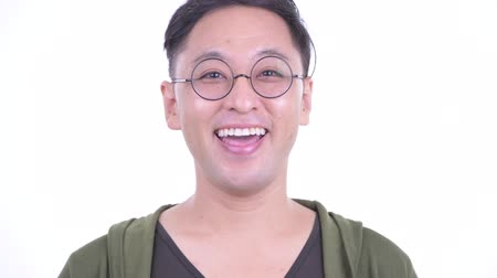 удовлетворения : Face of happy Japanese man with eyeglasses smiling