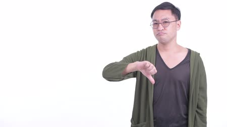 slecht nieuws : Stressed Japanese man with eyeglasses snapping fingers and giving thumbs down Stockvideo