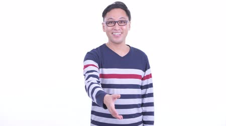 sendika : Happy Japanese hipster man with eyeglasses giving handshake Stok Video