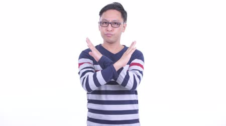 no hands : Stressed Japanese hipster man showing stop gesture