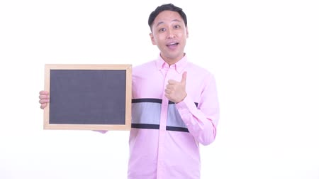 jóváhagyás : Happy Japanese businessman holding blackboard and giving thumbs up Stock mozgókép