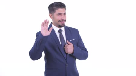 perzisch : Happy bearded Persian businessman waving hand Stockvideo