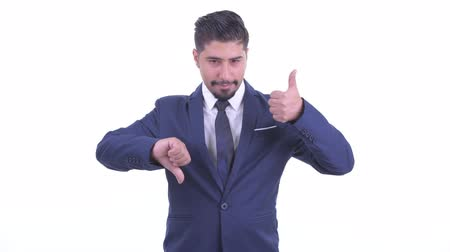 fikirler : Confused bearded Persian businessman choosing between thumbs up and thumbs down