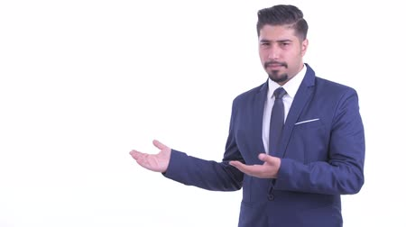 разочарование : Stressed bearded Persian businessman showing to the back and giving thumbs down Стоковые видеозаписи