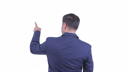 direkt : Rear view of bearded Persian businessman directing and pointing finger Stok Video