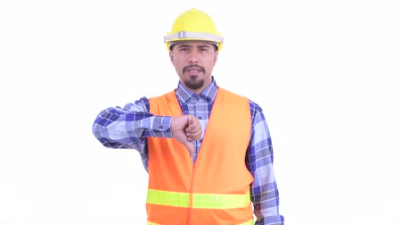 infastidito : Angry bearded Persian man construction worker giving thumbs down