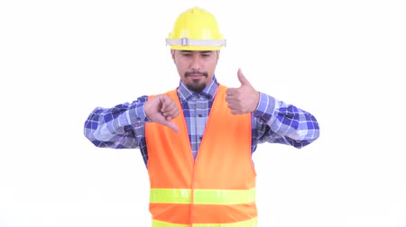 görüş : Confused bearded Persian man construction worker choosing between thumbs up and thumbs down