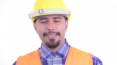 álmodozás : Face of happy bearded Persian man construction worker relaxing with eyes closed Stock mozgókép