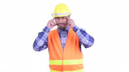 overweight : Stressed bearded Persian man construction worker having headache