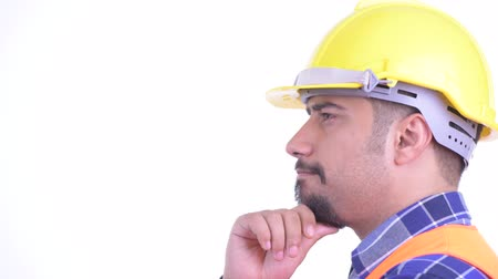 overweight : Closeup profile view of happy bearded Persian man construction worker thinking Stock Footage