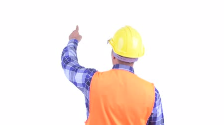direkt : Rear view of bearded Persian man construction worker directing and pointing finger