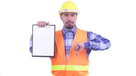 lista de verificação : Stressed bearded Persian man construction worker showing clipboard and giving thumbs down Stock Footage