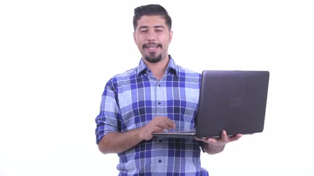 overweight : Happy bearded Persian hipster man talking while using laptop Stock Footage