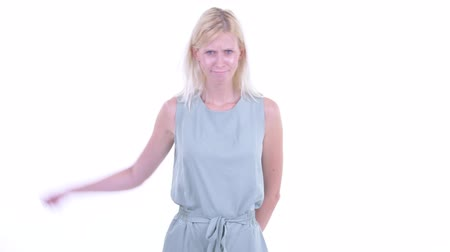 negatividade : Angry young blonde woman giving thumbs down