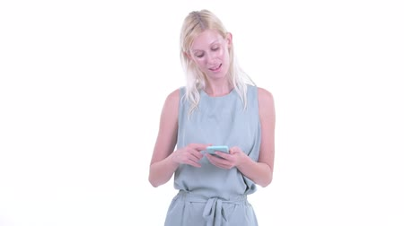 kolsuz : Happy young beautiful blonde woman thinking while using phone