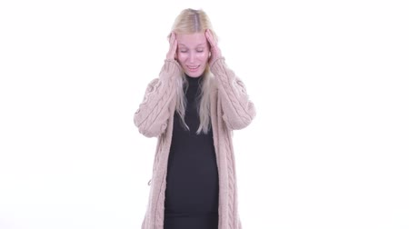 souffrir : Stressed young blonde pregnant woman having headache Vidéos Libres De Droits