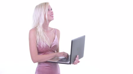 kolsuz : Happy young beautiful blonde woman thinking while using laptop