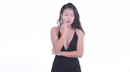 kolsuz : Stressed Asian woman thinking and looking down Stok Video