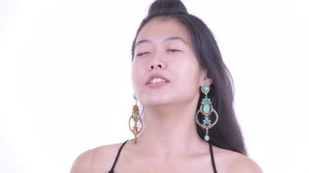 kolsuz : Face of happy beautiful Asian woman relaxing with eyes closed
