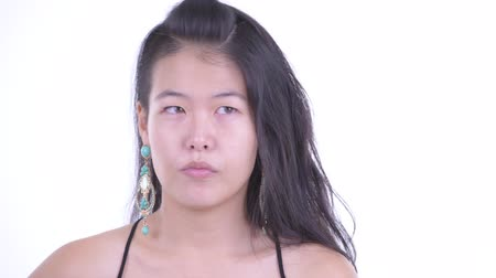 kolsuz : Face of stressed Asian woman looking bored and tired Stok Video
