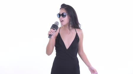 Happy beautiful Asian woman singing with microphone Wideo