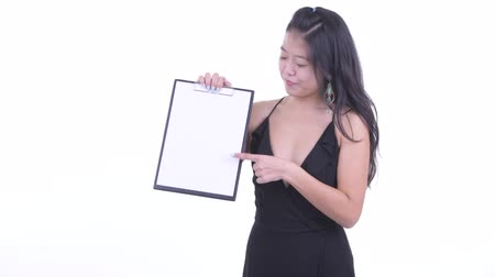 Happy beautiful Asian woman showing clipboard and giving thumbs up