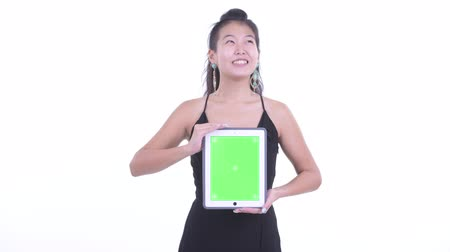 kolsuz : Happy beautiful Asian woman thinking while showing digital tablet