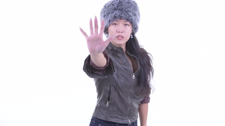 hanedan arması : Serious Asian woman showing stop gesture Stok Video
