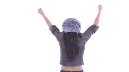 raising fist : Rear view of happy Asian woman with fists raised