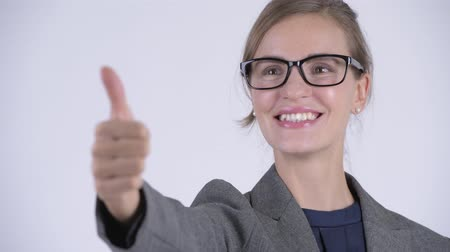 vastgebonden : Face of young happy businesswoman giving thumbs up Stockvideo