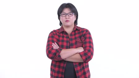 s rukama zkříženýma : Happy overweight Asian hipster woman smiling with arms crossed Dostupné videozáznamy