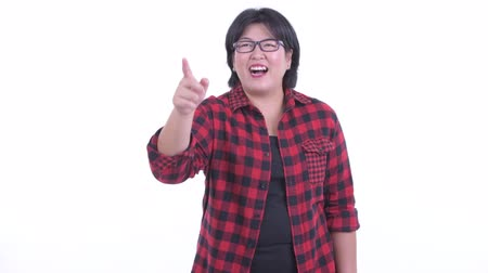 direto : Happy overweight Asian hipster woman pointing finger Stock Footage