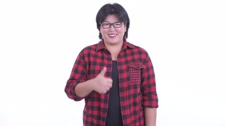 human like : Happy overweight Asian hipster woman giving thumbs up Stock Footage