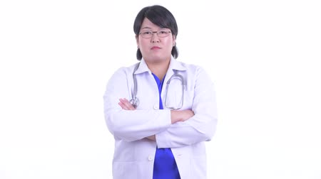 hanedan arması : Happy overweight Asian woman doctor smiling with arms crossed