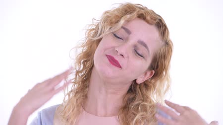 devanear : Face of happy beautiful blonde woman relaxing with eyes closed Stock Footage