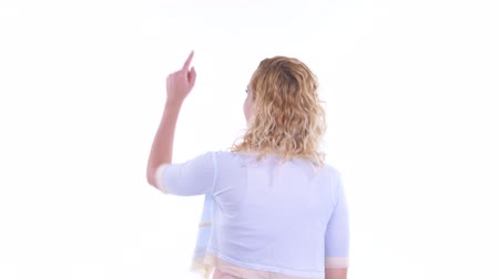 přímý : Rear view of blonde woman pointing finger and directing