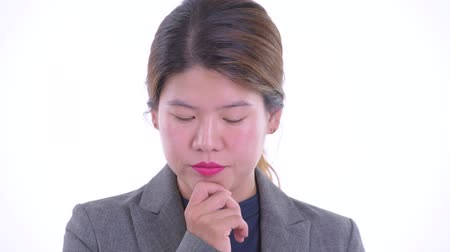 Face of stressed young Asian businesswoman thinking and looking down