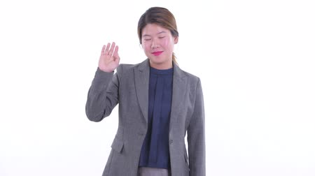 Happy young Asian businesswoman waving hand