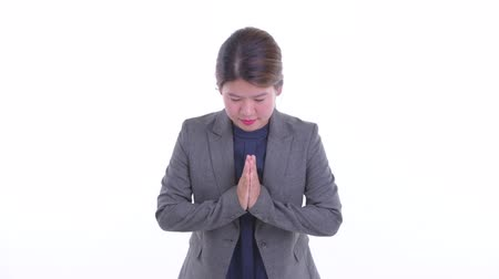 Happy young Asian businesswoman bowing with respect as greeting