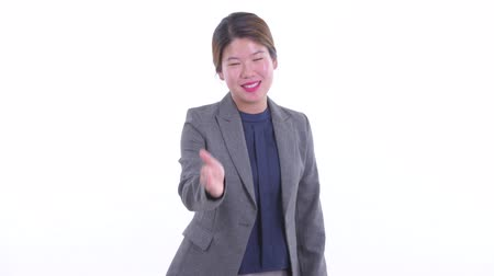 Happy young Asian businesswoman giving handshake Dostupné videozáznamy