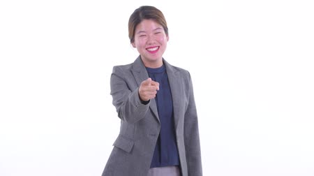 Happy young Asian businesswoman pointing at camera Dostupné videozáznamy