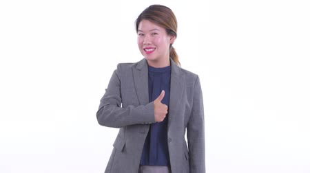 Happy young Asian businesswoman giving thumbs up