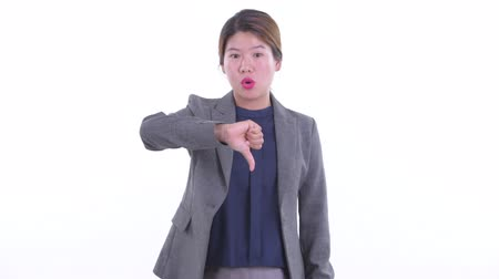 Angry young Asian businesswoman giving thumbs down Dostupné videozáznamy