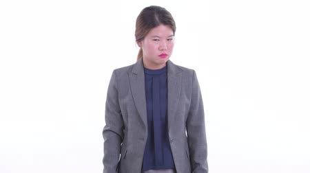 Sad young Asian businesswoman giving thumbs down Stockvideo