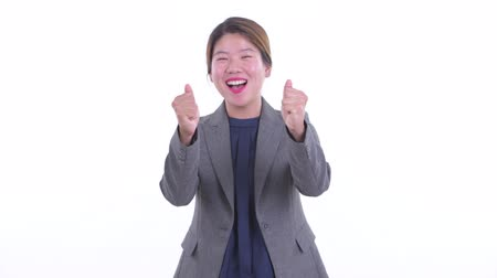 Happy young Asian businesswoman getting good news