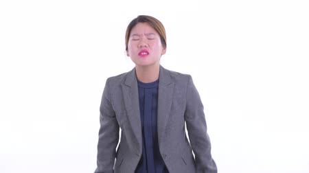 Stressed young Asian businesswoman getting bad news Dostupné videozáznamy