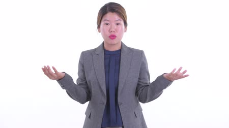 Young Asian businesswoman explaining something
