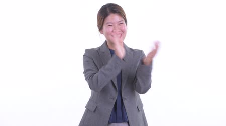 Happy young Asian businesswoman clapping hands