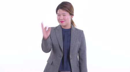 Happy young Asian businesswoman with ok sign